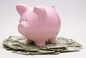 This piggy bank demands that you save every month.